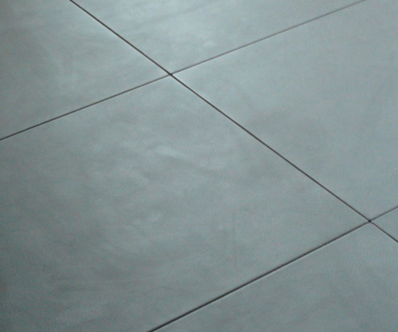 Zavos interiors leather walls doors floors for Faux leather floor tiles